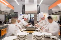A photo of chefs in the Hestan Kitchen at the CIA in Napa, California.