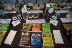 Photo of potato chip wine pairing class materials: wine, chip bags, glasses.