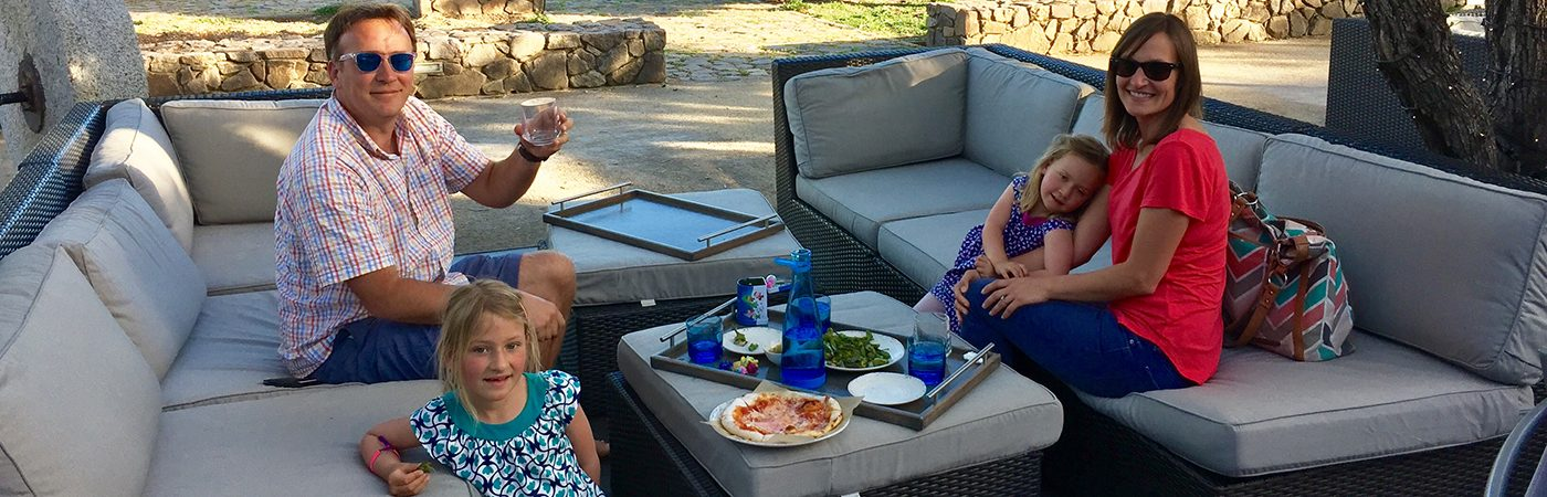 A family enjoying outdoor dining at Grove, at The CIA at Copia in downtown Napa, CA.