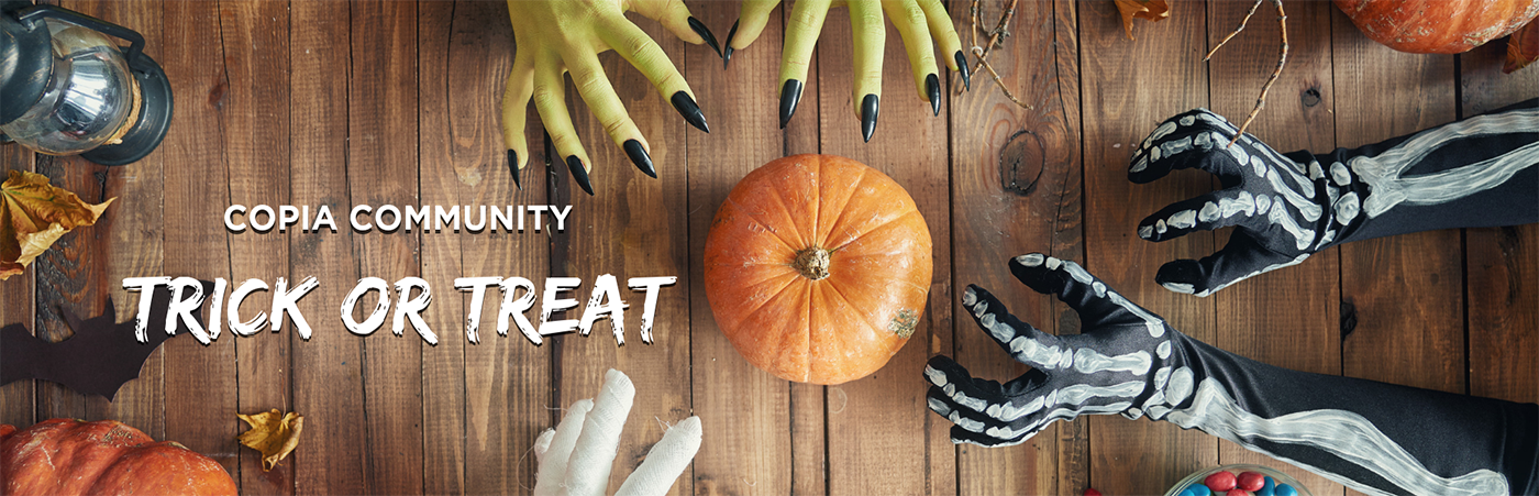 Copia Community Trick or Treat banner with monster hands grabbing a pumpkin.