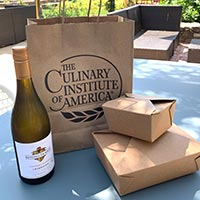 Take out bag and boxes for food and wine